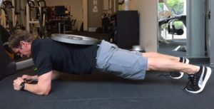 personal trainer Craig showing weighted plank