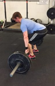 Personal trainer Craig shows start of deadlift